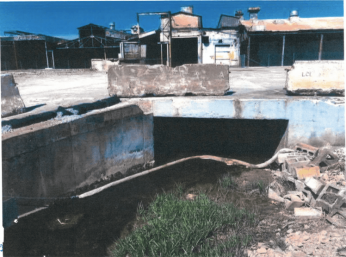 Spring Creek buried beneath slab of concrete