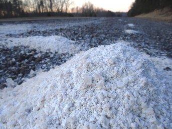 Pile of road salt on concrete