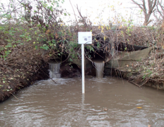 The Davis Culvert pouring into the Pike River