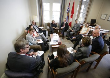 A circle of politicians and environmentalists discuss policy
