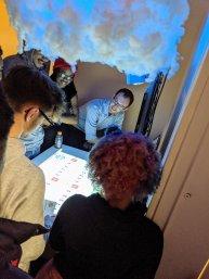 Student ambassadors surround Reflo's interactive water table